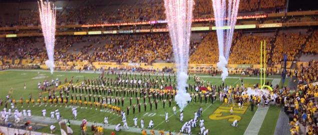ASU football team takes the field in the opening game of the 2013 season.