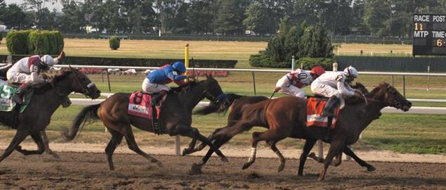 Drosselmeyer (#7) leads into the stretch, followed by First Dude, Game On Dude (#8)