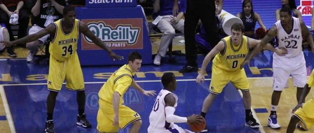 Michigan Wolverines men's basketball team defend against the University of Kansas