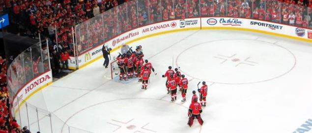 Calgary Flames celebrate after eliminating the Canucks in the first round of '15 Playoffs.