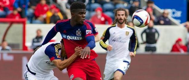 Chicago Fire's Jason Johnson getting tackled by a RSL player after passing the ball