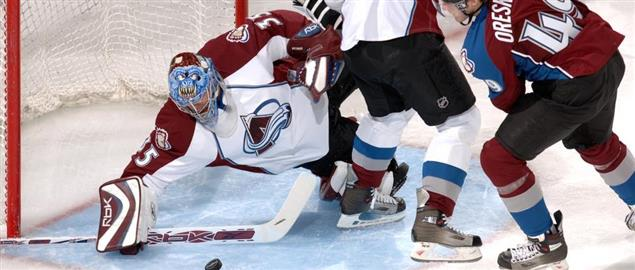 Avalanche rookie goalie Tyler Weiman slides to make a save in traffic during scrimmage.