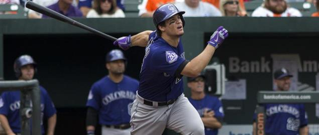 Nolan Arenado of the Colorado Rockies batting against the Orioles in Baltimore, 8/18/13.