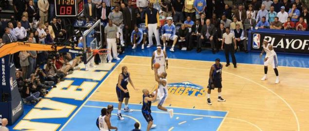 Denver Nuggets' Dahntay Jones attempts jump shot over the Dallas Mavericks' Dirk Nowitzki.
