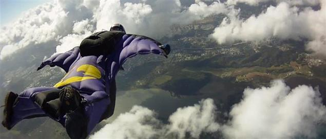 Wingsuit High Altitude Skydiving through the fluffy clouds