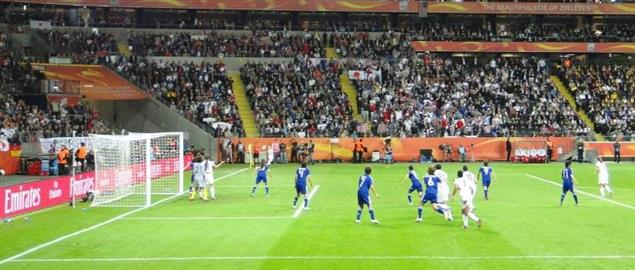 Corner kick. Japan defends, USA attacks during 2011 Women's World Cup.