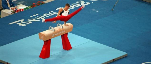 Alexander Artemev on the pommel horse at the 2008 Beijing Olympics.