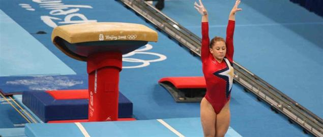 Shawn Johnson competing at the 2008 Summer Olympics competing on vault.