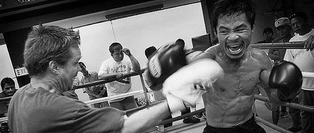 Manny pacman Pacquiao with his coach Freddie Roach