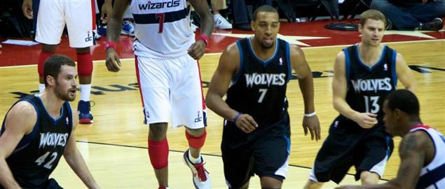 Trevor Booker makes a move as three Timberwolves collapse on defense as Wall and Blatche