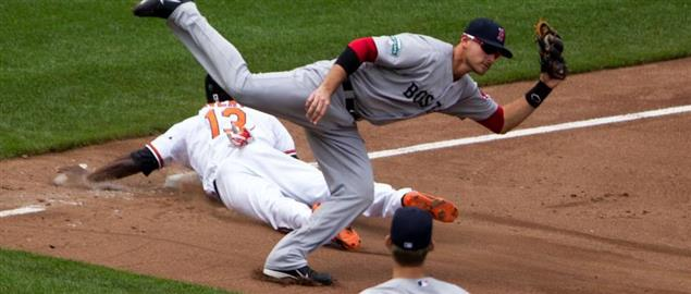 Red Sox's Middlebrook leaps over Orioles' Avery, tagging him for stolen base try. 05/23/12