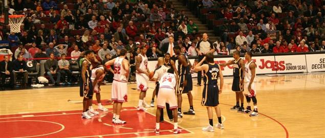 Jump ball at free throw line at Indiana Pacers at Chicago Bulls basketball game.