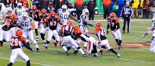 Bengals defensive line players play against the New York Jets offense in the Wild Card
