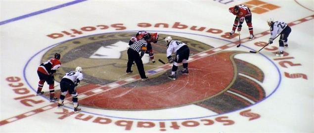 Faceoff during first playoff game between Senators and TB Lightning, 2006 Stanley Cup.