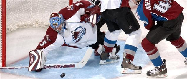 Colorado Avalanche rookie goalie Tyler Weiman slides to make a save