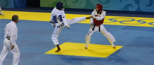 2008 Summer Olympics Taekwondo - Mildred Alango (KEN, blue) v. Wu Jingyu. (CHN, red)