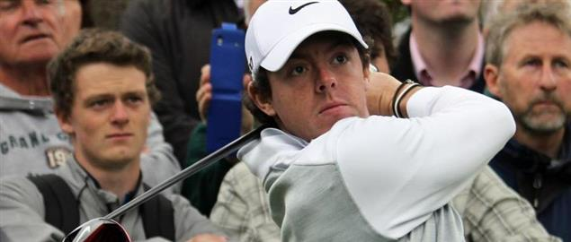 Crowd of onlookers watch Rory McIlroy drive during practice, '13 BMW PGA Championship.