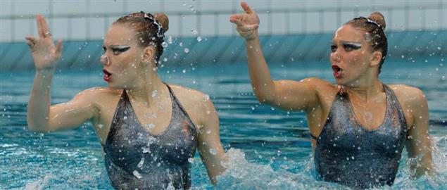 Russian synchronized swimmers Alla Vaskovich and Alena Zhebeleva, in a 2013 Duet exercise