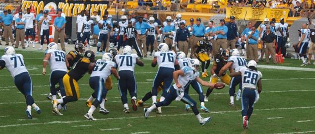 Jake Locker hands off the football to Chris Johnson vs. Pittsburgh Steelers, 9/8/13.