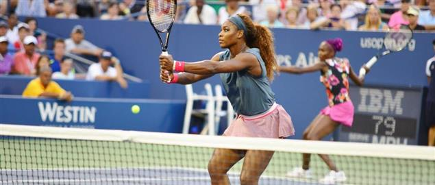 Serena Williams in the 1st round doubles action from the Women's draw at the 2013 US Open.