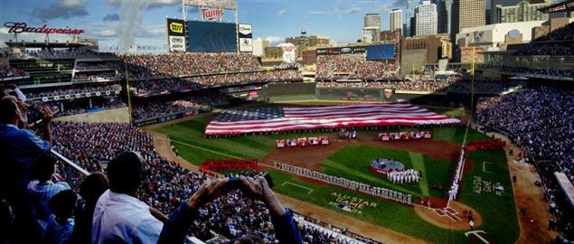 The U.S. Air Force Thunderbirds perform the flyover during the national anthem at the MLB